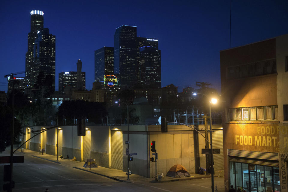 FILE - In this April 25, 2016, file photo, homeless people sleep in the Skid Row area of downtown Los Angeles. A federal judge overseeing a sweeping lawsuit about homelessness in Los Angeles on Tuesday, April 20, 2021, ordered the city and county to find shelter for all unhoused residents of Skid Row within 180 days and audit any spending related to the out-of-control crisis of people living on the streets. (AP Photo/Jae C. Hong, File)