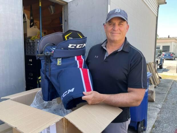 David Bellaire, owner of Belle River Source For Sports, said sales of hockey gear have double what they usually are this time of year. (Amy Dodge/CBC - image credit)