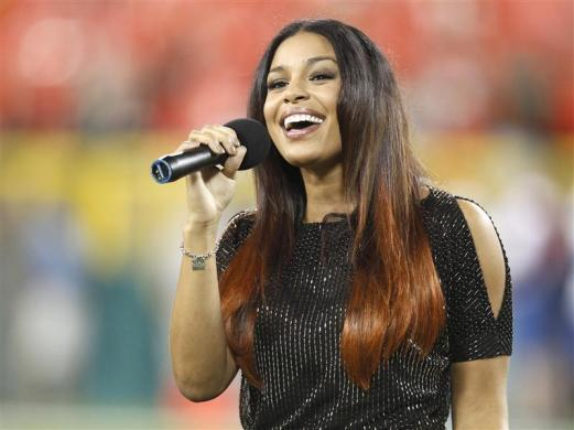 Jordin Sparks sings the National Anthem from Lambeau Field before the Green Bay Packers against the New Orleans Saints NFL game in Green Bay, Wisconsin, September 8, 2011.