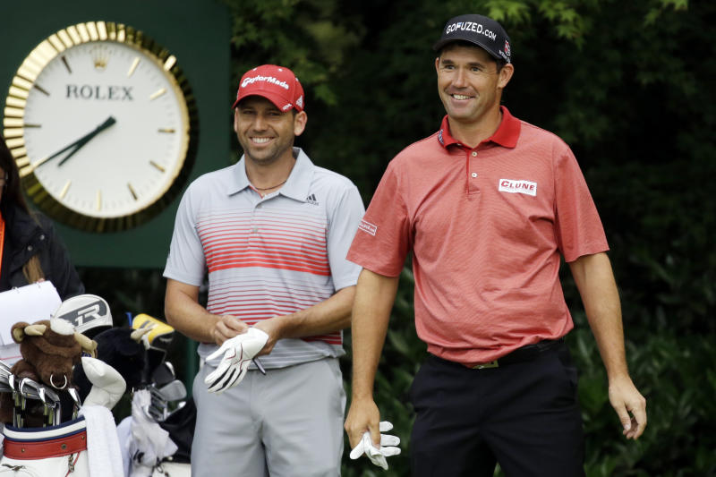 Padraig Harrington, right, of Ireland, and Sergio Garcia, of Spain, laugh before teeing off on the 11th hole during the first round of the U.S. Open golf tournament at Merion Golf Club, Thursday, June 13, 2013, in Ardmore, Pa. (AP Photo/Morry Gash)