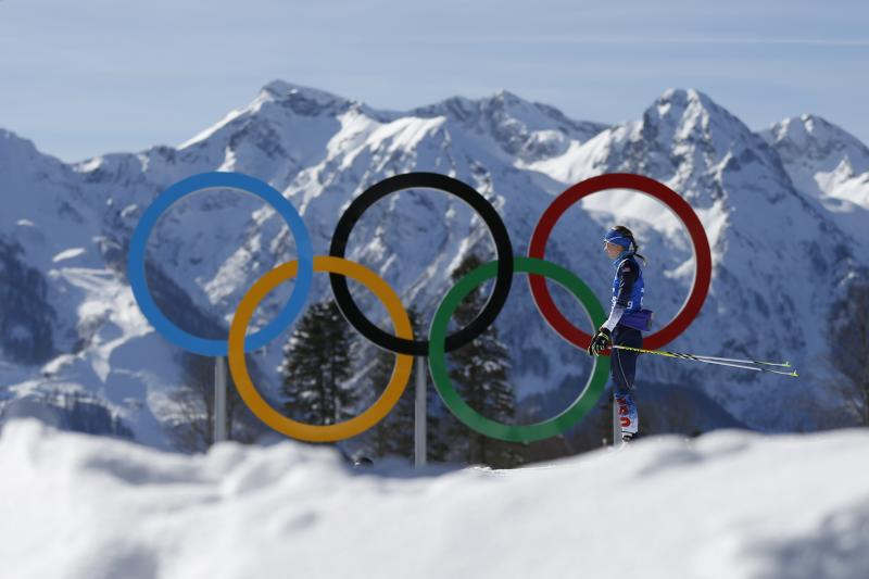 Annelies Cook of the United States passes by the Olympic rings during a biathlon training session prior to the 2014 Winter Olympics, Friday, Feb. 7, 2014, in Krasnaya Polyana, Russia. (AP Photo/Felipe Dana)