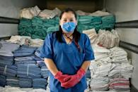 Idalia Diaz has seen the amount of garbage that she has to deal with grow relentlessly, but she gets on with her work without complaining
