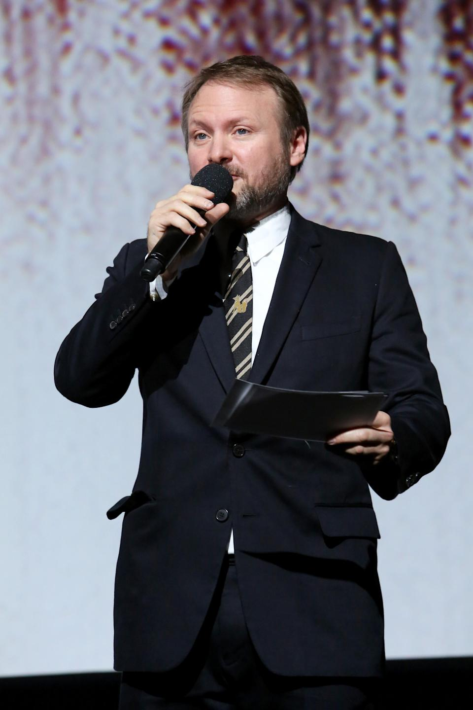 Writer-director Rian Johnson introduces the film. (Photo: Jesse Grant/Getty Images for Disney)