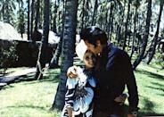 <p>Elvis Presley gives his wife, Priscilla, an affectionate kiss on the forehead as the couple vacations in Hawaii in 1968 after welcoming their daughter.</p>