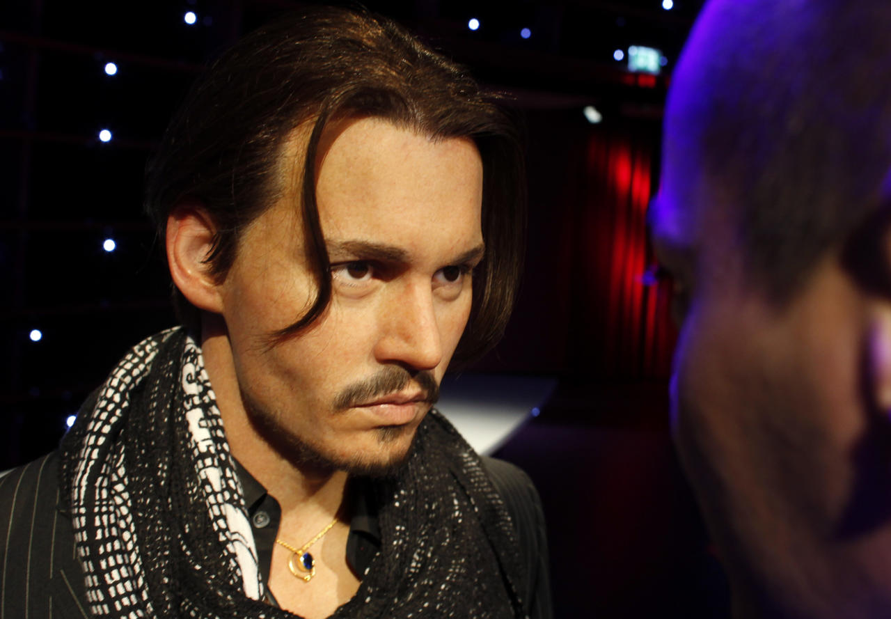 A man looks at a wax figure of actor Johnny Depp at the opening of Madame Tussauds in Vienna March 31, 2011. Sixty-three wax figures can be seen from April 1 at Vienna's Madame Tussauds, which is the eleventh branch of the popular tourist attraction in the world.   REUTERS/Herwig Prammer