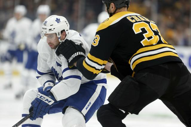 Boston Bruins' Zdeno Chara (33) works against Toronto Maple Leafs' John Tavares (91) for the puck during the first period in Game 5 of an NHL hockey first-round playoff series in Boston, Friday, April 19, 2019. (AP Photo/Michael Dwyer)