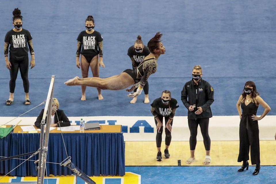 UCLA gymnast Margzetta Frazier competes in the uneven parallel bars.