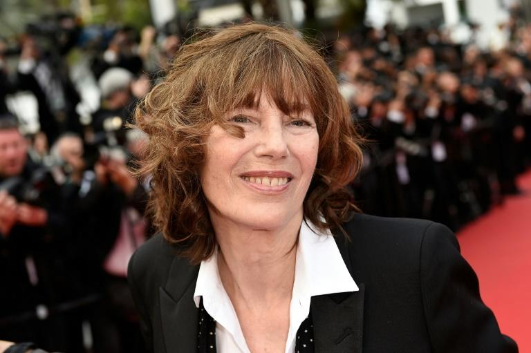 British actress and singer Jane Birkin poses as she arrives for the closing ceremony of the 68th Cannes Film Festival in Cannes, southeastern France, in 2015