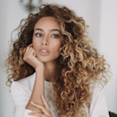 """We've been infusing brunettes with dimensions ranging from shades of honey, chestnut, peanut butter-taupes, and tawny tones,"" says DeBolt. ""Warmth in hair color reflects more light, which makes your hair look brighter and healthier."" Subtler swirls of color look great on straight hair, while bolder highlights make curls pop."