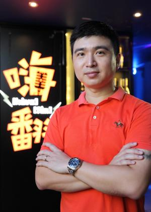 Medium shot of Flint Lu, owner of HaveFun Family KTV, the anchor tenant at Bugis Cube