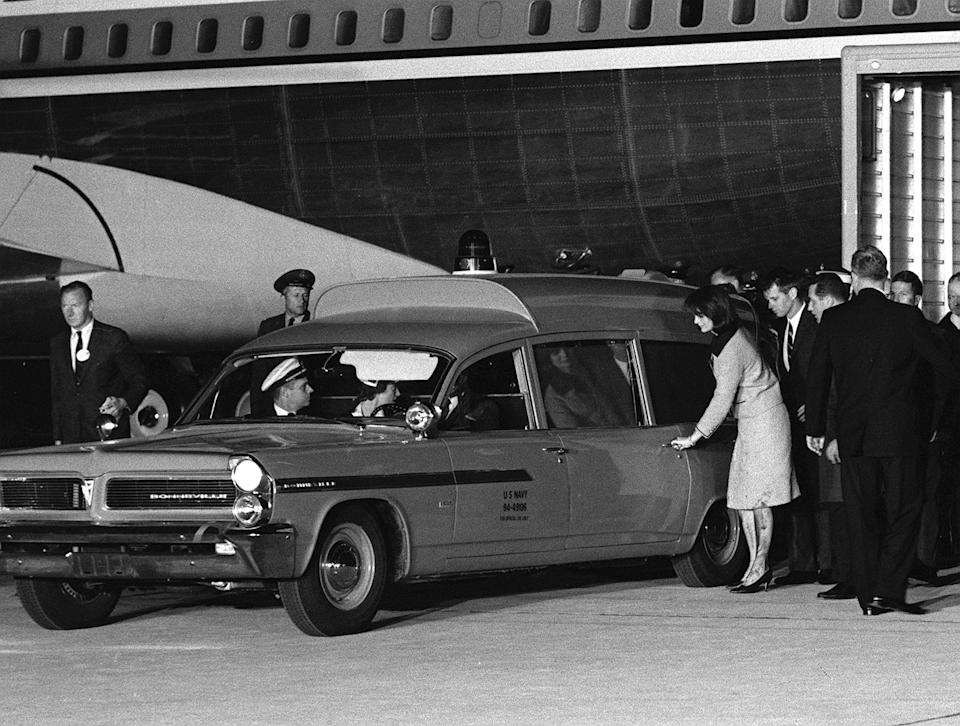 Her stockings and dress soiled, widowed first lady Jacqueline Kennedy reaches for the door of the ambulance carrying the body of her slain husband at Andrews Air Force Base, Md., on Nov. 22, 1963. The late President's brother, Attorney General Robert F. Kennedy, accompanies her at right. The first lady had just arrived from Dallas with her husband's body aboard a presidential jet. (Photo: AP)