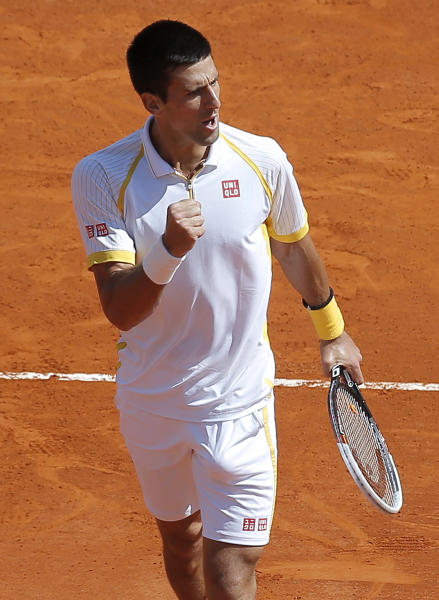 Novak Djokovic of Serbia reacts during his final match of the Monte Carlo Tennis Masters tournament in Monaco against Spain's Rafael Nadal, Sunday, April 21, 2013. (AP Photo/Lionel Cironneau)