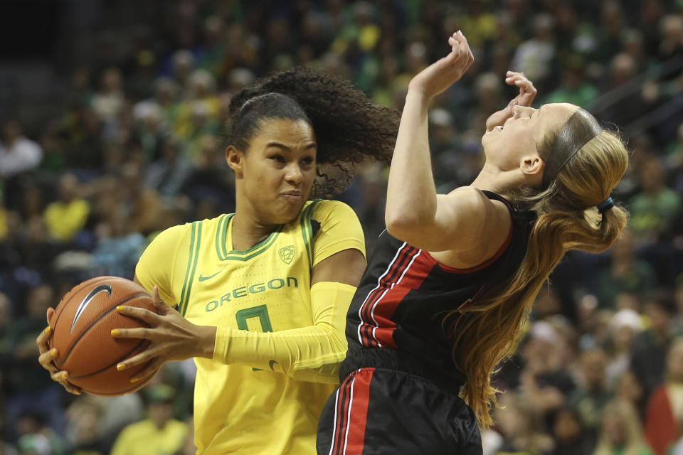 Oregon's Satou Sabally, left, picks up a player control foul against Utah's Dru Gylten during the second quarter of an NCAA college basketball game in Eugene, Ore., Sunday, Jan. 5, 2020. (AP Photo/Chris Pietsch)