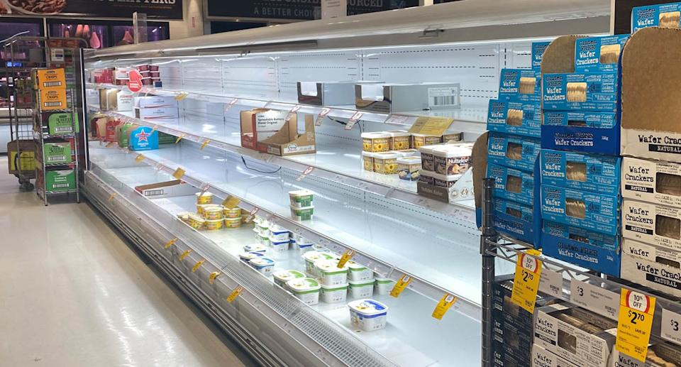 Shoppers are Coles and Woolworths supermarkets are faced with empty shelves as mass Covid isolations create major stock shortages across Sydney.