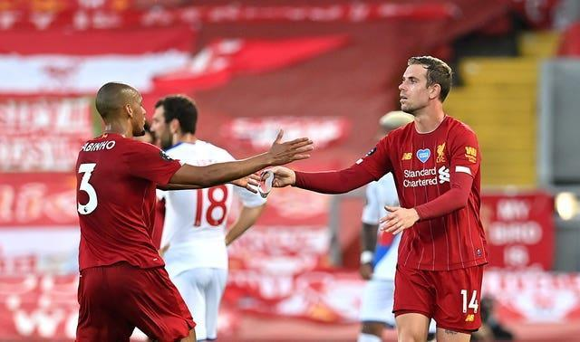 Fabinho and Liverpool captain Jordan Henderson greet each other on the pitch