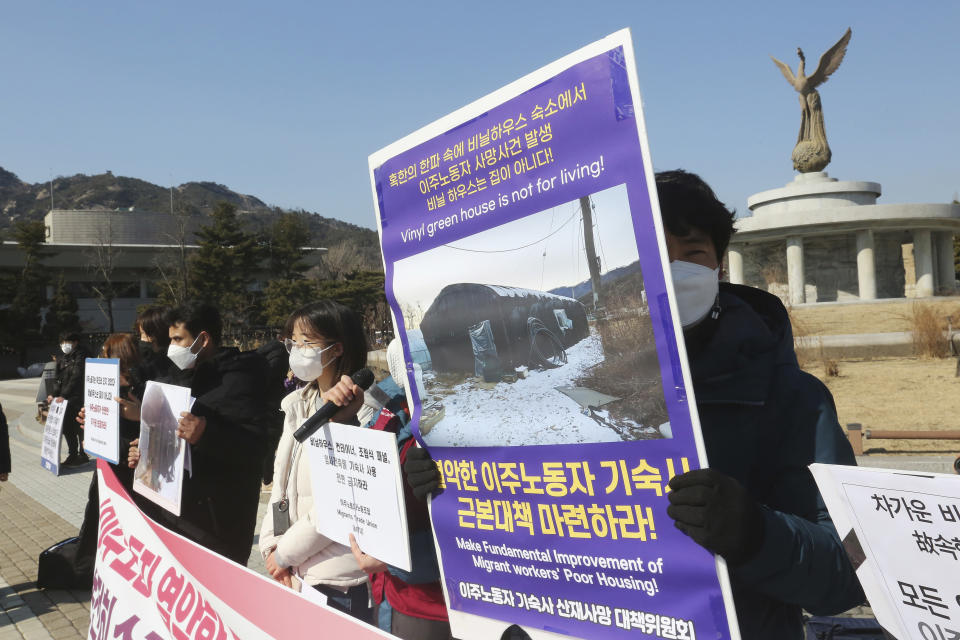 Human rights activists stage a rally calling for better living conditions for migrant workers near the presidential Blue House in Seoul, South Korea on Feb. 9, 2021. Activists and workers say migrant workers in Pocheon work 10 to 15 hours a day, with only two Saturdays off per month. They earn around $1,300-1,600 per month, well below the legal minimum wage their contracts are supposed to ensure. (AP Photo/Ahn Young-joon)