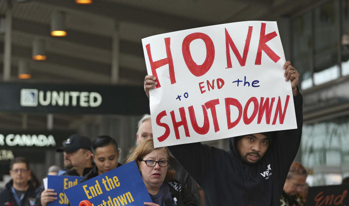 More than two dozen federal employees and supporters demonstrate at the Sacramento International Airport calling for President Donald Trump and Washington lawmakers to end then partial government shutdown, Wednesday, Jan. 16, 2019, in Sacramento, Calif. (Photo: Rich Pedroncelli/AP)
