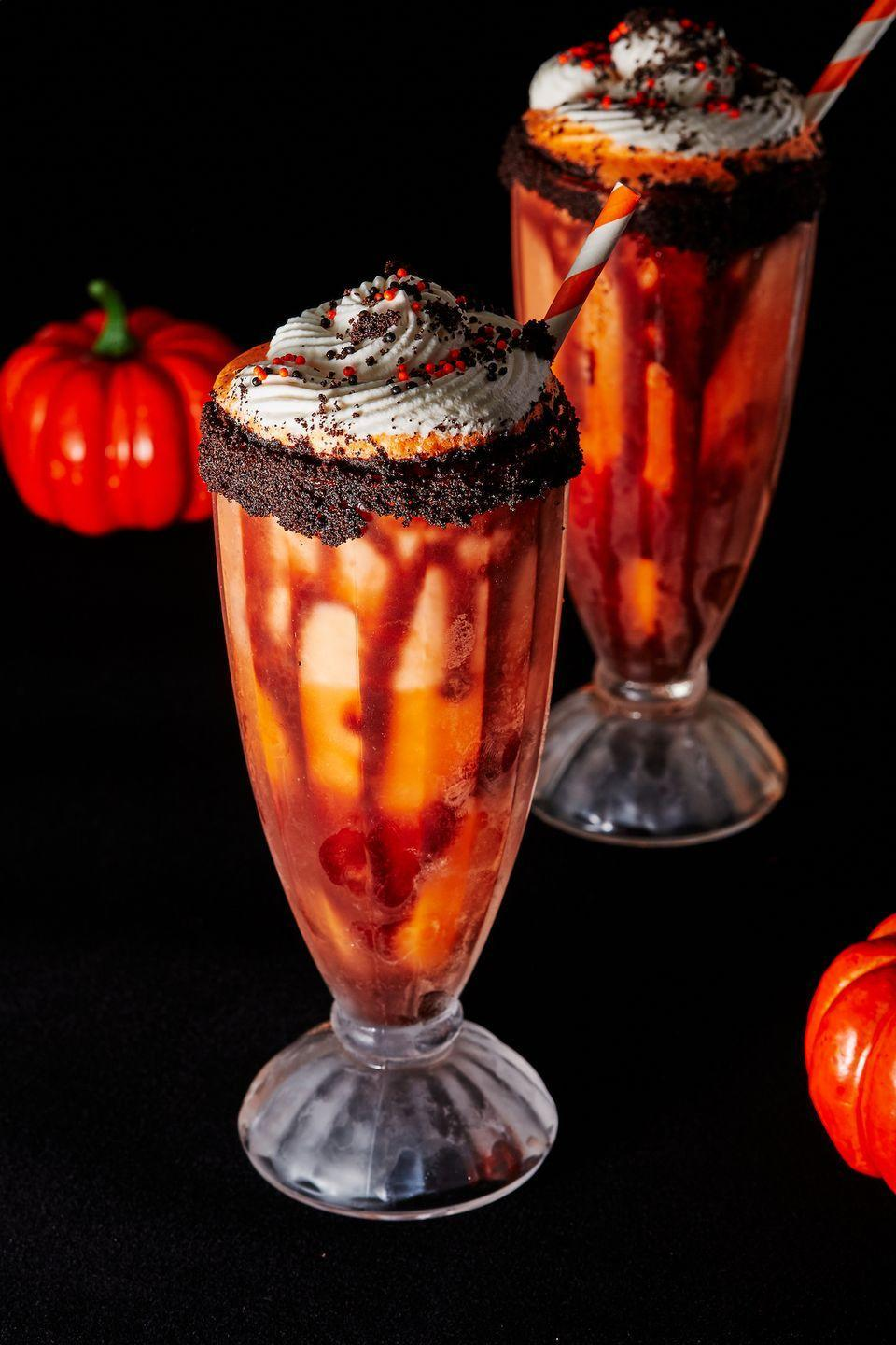 "<p>Boozy milkshakes bring everyone to the yard...</p><p>Get the recipe from <a href=""https://www.delish.com/holiday-recipes/halloween/a29007809/boozy-screamsicle-shakes-recipe/"" rel=""nofollow noopener"" target=""_blank"" data-ylk=""slk:Delish"" class=""link rapid-noclick-resp"">Delish</a>. </p>"