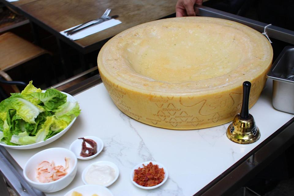 When a dish from the cheese wheel menu is ordered, a waiter will ring a bell and push a cart with the cheese wheel next to your table. The food is tossed and mixed in the wheel before it is served with cheese shavings. (Photo: Yahoo Singapore)