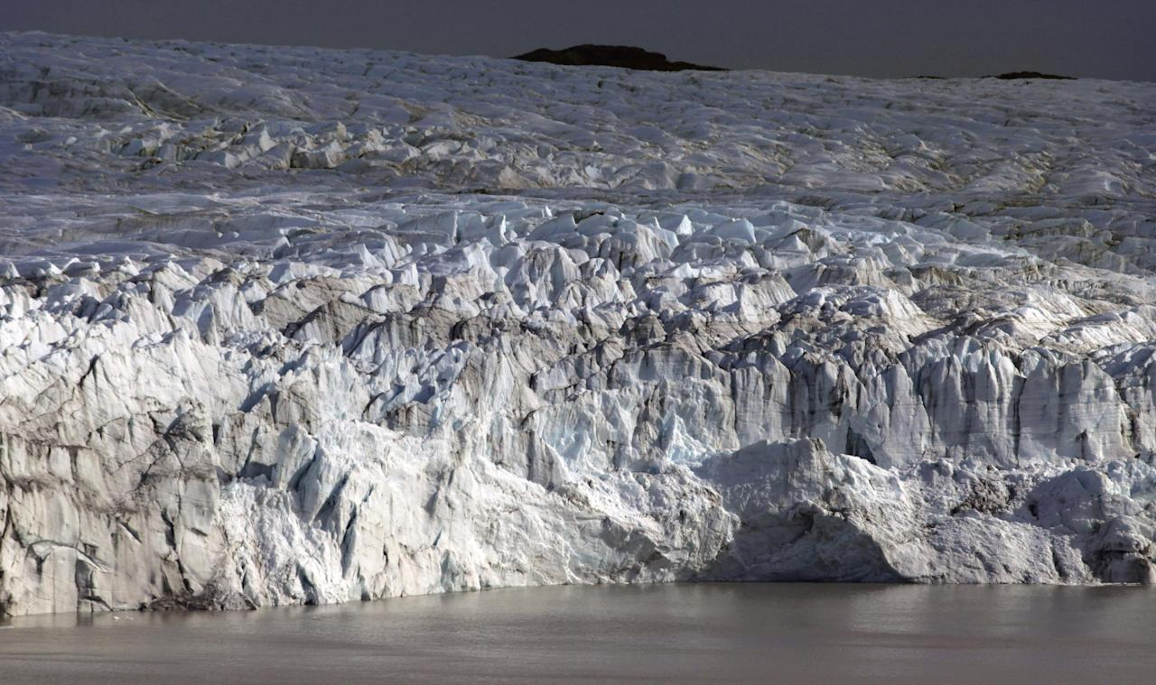 This July 17, 2011 photo shows the melting front of a glacier at the edge of the Greenland ice sheet, near Kangerlussuaq, Greenland. Greenland is the focus of many researchers trying to determine how much its melting ice may raise sea levels. (AP Photo/Brennan Linsley)