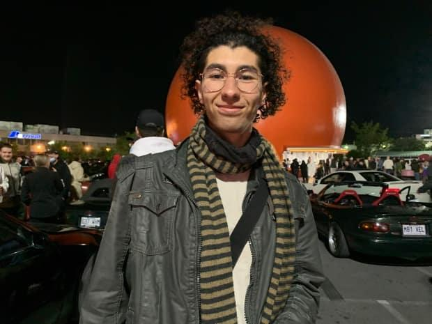 AnisDjebassi was one of thousands of Montrealers who took to the streets to celebrate the lifting of curfew and enjoy a night out with friends. (Sharon Yonan Renold/CBC - image credit)