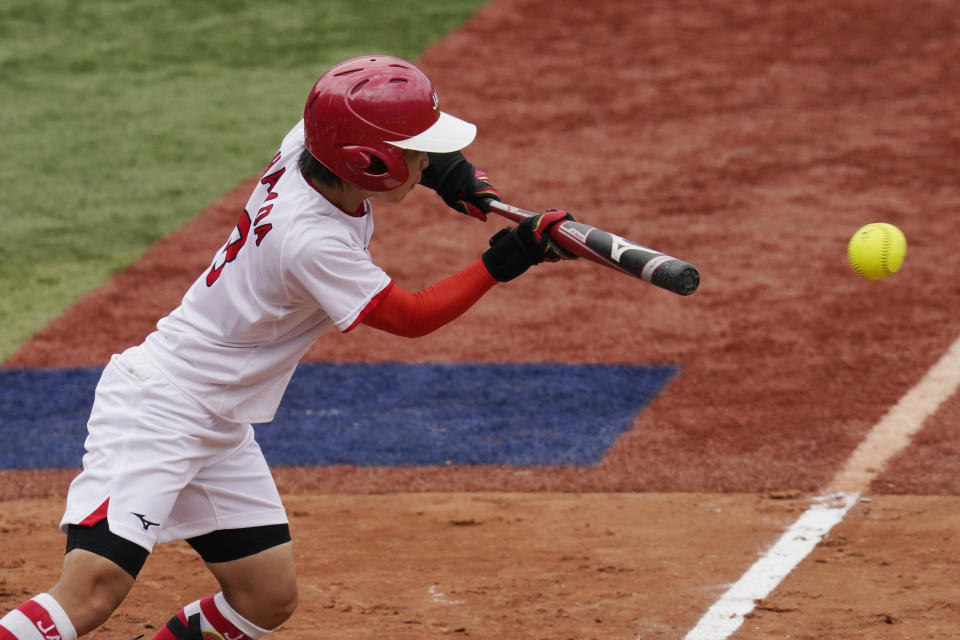 Japan's Nodoka Harada attempts a bunt but grounds out in the fifth inning of a softball game against the United States at the 2020 Summer Olympics, Monday, July 26, 2021, in Yokohama, Japan. (AP Photo/Sue Ogrocki)