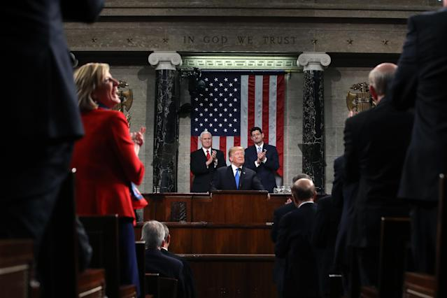<p>Trump, center, pauses while delivering his first State of the Union address to a joint session of Congress at the U.S. Capitol in Washington, D.C., on Jan. 30. (Photo: Win McNamee/Pool via Bloomberg) </p>