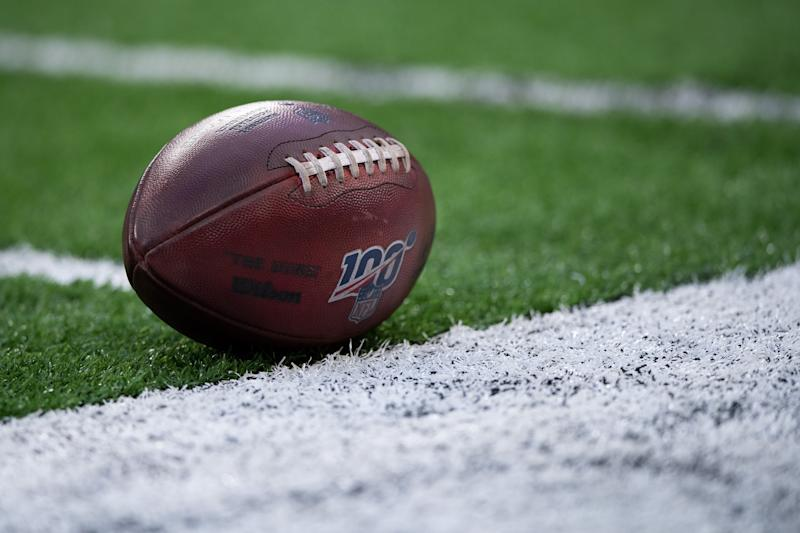 INDIANAPOLIS, IN - AUGUST 24: NFL football with the 100 year logo sits on the field during the week 3 NFL preseason game between the Chicago Bears and Indianapolis Colts on August 24, 2019 at Lucas Oil Stadium, in Indianapolis, IN. (Photo by Zach Bolinger/Icon Sportswire via Getty Images)