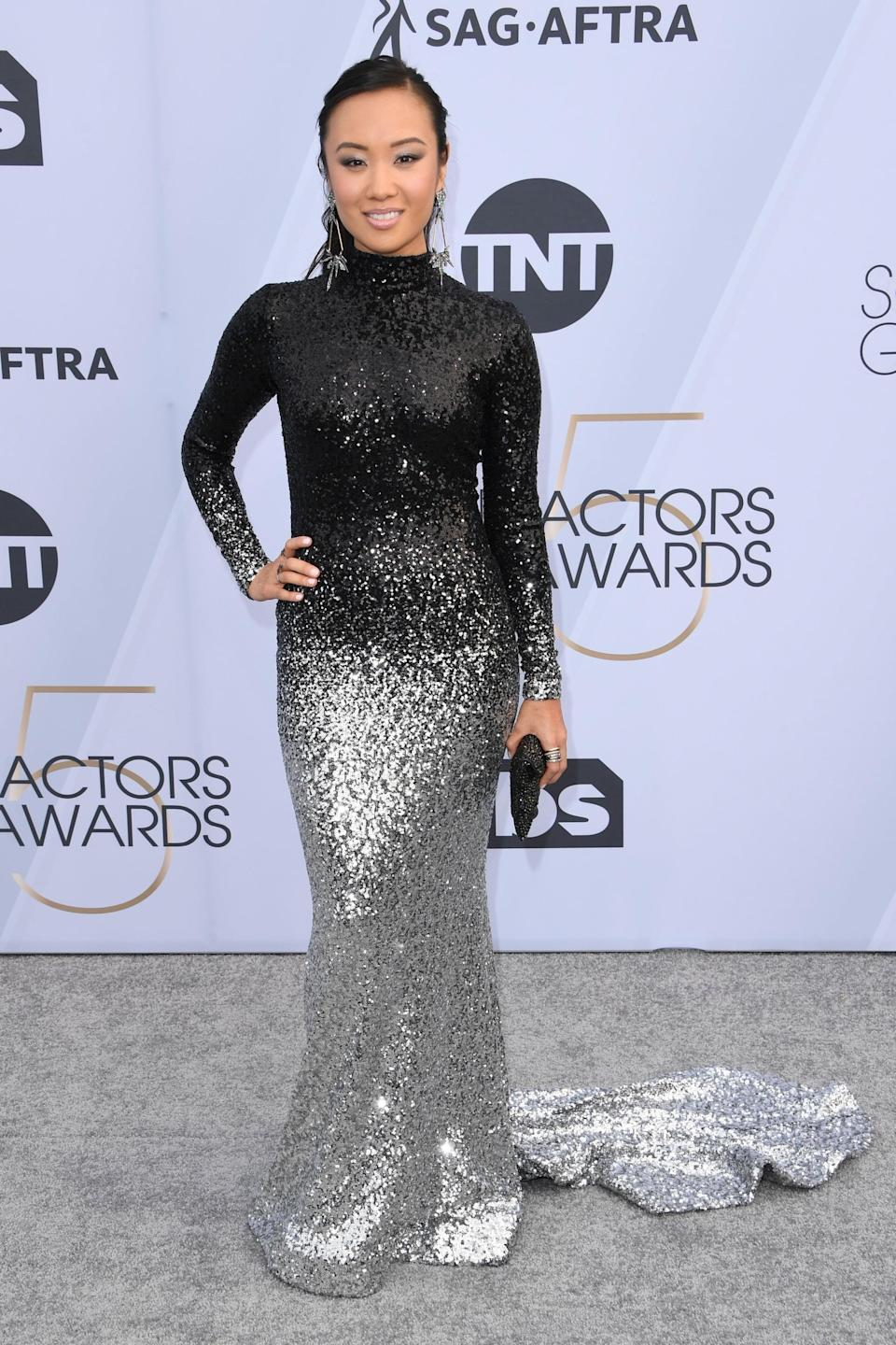 <p>Wearing a black and silver Kelly NG gown with Alexis Bittar jewels and Stuart Weitzman heels.</p>