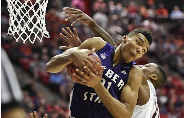 Weber State's Joel Bolomboy pulls a rebound away from Arizona forward Rondae Hollis-Jefferson during the second half in a second-round game in the NCAA college basketball tournament Friday, March 21, 2014, in San Diego. (AP Photo/Denis Poroy)
