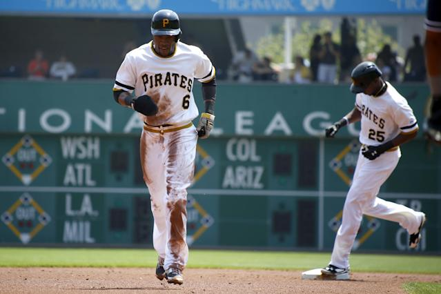 Pittsburgh Pirates' Starling Marte (6) is chased from second as teammate Gregory Polanco rounds the base after hitting a two-run home run in the first inning of the baseball game against the San Diego Padres on Sunday, Aug. 10, 2014, in Pittsburgh. (AP Photo/Keith Srakocic)