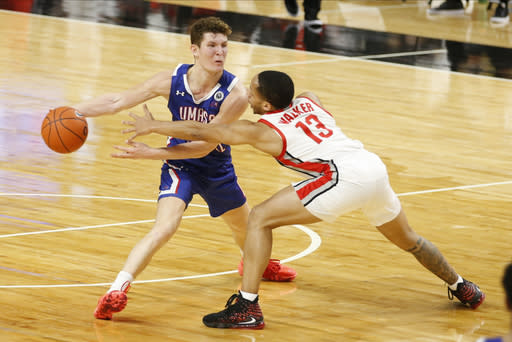 UMass-Lowell's Bryce Daley, left, keeps the ball away from Ohio State's C.J. Walker during the second half of an NCAA college basketball game Sunday, Nov. 29, 2020, in Columbus, Ohio. (AP Photo/Jay LaPrete)