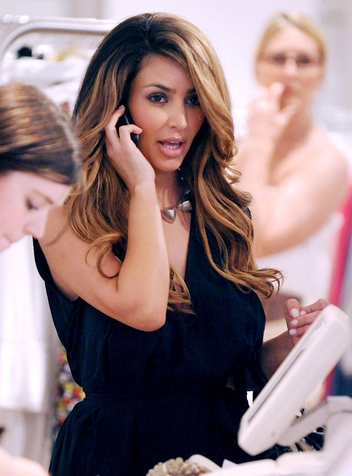 """Kim Kardashian donned a blond wig while shopping in New York City last weekend. The reality star liked her look so much that she told Us Magazine she might dye her hair this summer. James Devaney/<a href=""""http://www.wireimage.com"""" target=""""new"""">WireImage.com</a> - April 26, 2009"""
