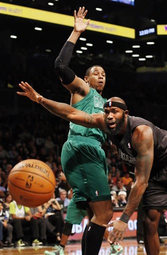 Boston Celtics forward Jared Sullinger (7) and Brooklyn Nets forward Reggie Evans (30) scramble after a rebound in the first half of their NBA basketball game at the Barclays Center, Tuesday, Dec. 25, 2012, in New York. (AP Photo/John Minchillo)
