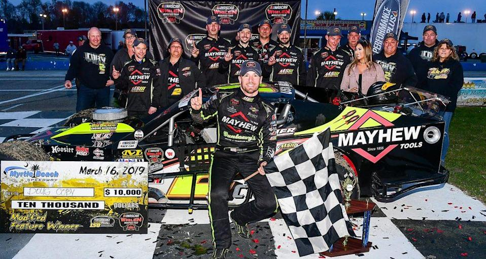 MYRTLE BEACH, SC - MARCH 16: Doug Coby, driver of the #2 Mayhew Tools Chevrolet, celebrates in victory lane after winning the NASCAR Whelen Modified Performance Plus 150 presented by Safety-Kleen on March 16, 2019 at Myrtle Beach Speedway in Myrtle Beach, South Carolina. (Adam Glanzman/NASCAR)