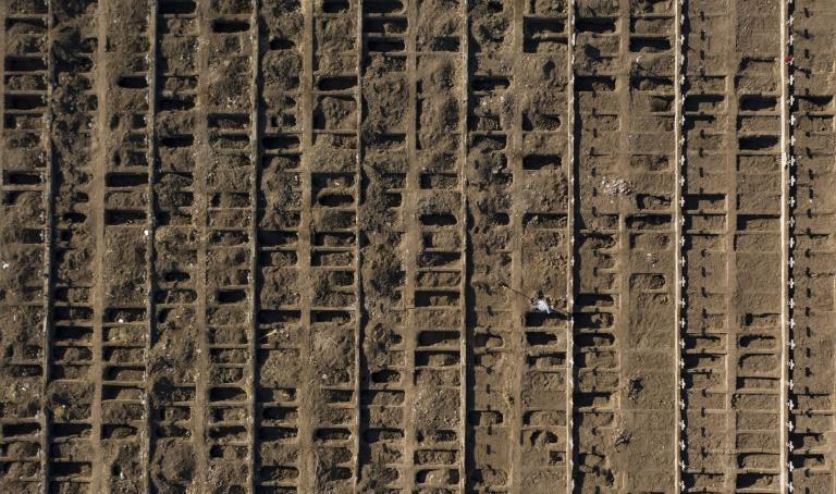 Gravediggers were preparing 2,000 fresh graves to cope with the pandemic (AFP Photo/MARTIN BERNETTI)
