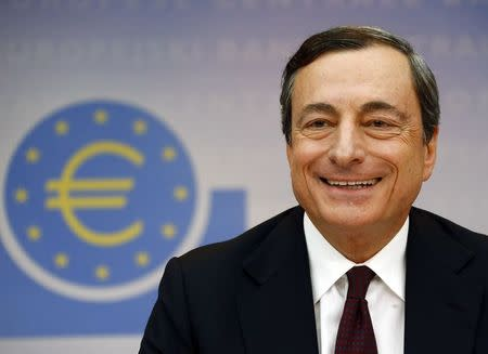 European Central Bank President Mario Draghi smiles during the bank's monthly news conference in Frankfurt