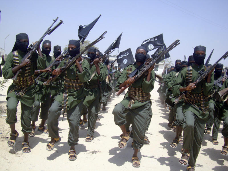 FILE - In this Thursday, Feb.17, 2011 file photo, al-Shabab fighters march with their weapons during military exercises on the outskirts of Mogadishu, Somalia. An intelligence intercept from al-Qaida-linked Somali militant group al-Shabab shows that insurgents are being offered up to $8,000 to kill Kenyan security officers, a Kenyan official said Thursday, Dec. 13, 2012. (AP Photo/Mohamed Sheikh Nor, File)