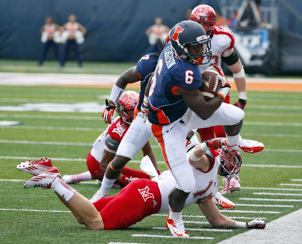Illinois running back Josh Ferguson (6) is forced out of bounds by Miami (Ohio) defensive back Jay Mastin (14) during the first half of an NCAA college football game on Saturday, Sept. 28, 2013, at Memorial Stadium in Champaign, Ill. (AP Photo/Jeff Haynes)