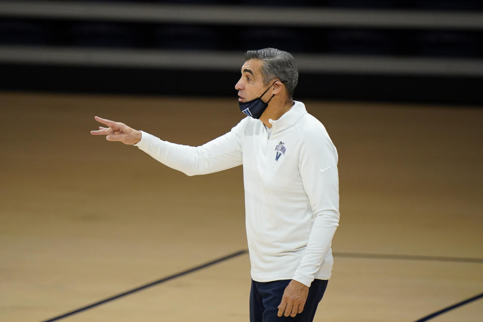 Villanova's Jay Wright coaches during an NCAA college basketball game against Saint Joseph's, Saturday, Dec. 19, 2020, in Villanova, Pa. (AP Photo/Matt Slocum)