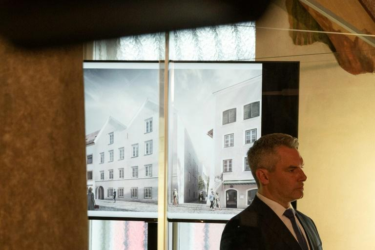 Austrian Interior Minister Karl Nehammer presents the plan for the redesign of the house in Braunau where Adolf Hitler was born in 1889 (AFP Photo/JOE KLAMAR)