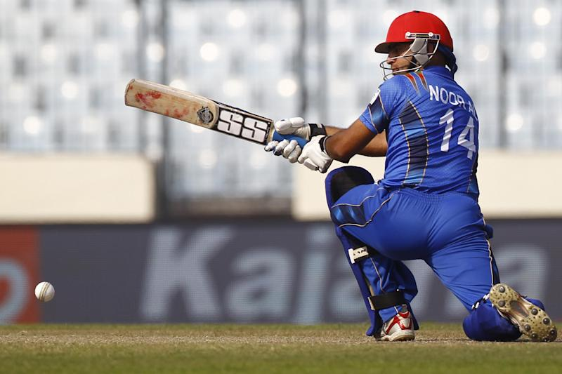 Afghan cricket player Noor Ali Zadran bats during the Asia Cup one-day international cricket tournament against India in Dhaka, Bangladesh, Wednesday, March 5, 2014. (AP Photo/A.M. Ahad)