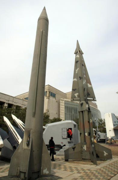 Foreign visitors walk around mock North Korea's Scud-B missile, left, and other South Korean missiles at Korea War Memorial Museum in Seoul, Monday, March 19, 2012. North Korea vowed Sunday to go ahead with plans to launch a long-range rocket, rejecting criticism in the West that it would scuttle recent diplomacy. (AP Photo/Lee Jin-man)