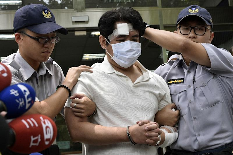 "Lu Chun-yi was carrying hand-written notes threatening to ""behead"" Taiwan's President Tsai Ing-wen (AFP Photo/SAM YEH)"