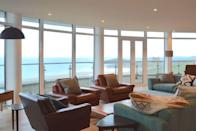 """<p>High on a hill on the Cornish coast lies a truly idyllic retreat for design-loving urbanites - a <a href=""""https://www.harpersbazaar.com/uk/travel/news/a42897/cornwall-beach-apartments/"""" rel=""""nofollow noopener"""" target=""""_blank"""" data-ylk=""""slk:sprawling two-floor penthouse"""" class=""""link rapid-noclick-resp"""">sprawling two-floor penthouse</a> complete with an expansive rooftop terrace and jacuzzi. It's the perfect destination for big groups (the space sleeps up to 10) to enjoy a weekend away by the sea. </p><p>To book, visit <a class=""""link rapid-noclick-resp"""" href=""""http://www.tregullandandco.co.uk/"""" rel=""""nofollow noopener"""" target=""""_blank"""" data-ylk=""""slk:tregullandandco.co.uk"""">tregullandandco.co.uk</a> or ring 01566 770880.</p>"""