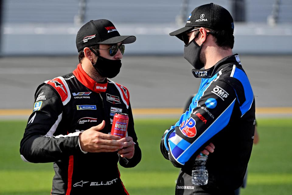 <em>Chase Elliott and Alexander Rossi, who share a primary sponsor (NAPA) in their other full-time auto racing gigs, talk in the pits before the Rolex 24 at Daytona (Jasen Vinlove/USA TODAY Sports).</em>