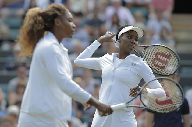 Serena Williams and Venus Williams at Wimbledon last month. (AP Photo/Pavel Golovkin)