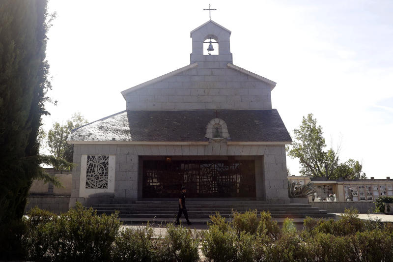 In this photo taken on Thursday, Oct. 3, 2019, a Spanish police walks past Franco's family tomb in Mingorrubio's cemetery, outskirts of Madrid. After a tortuous judicial and public relations battle, Spain's Socialist government has announced that Gen. Francisco Franco's embalmed body will be relocated from a controversial shrine to a small public cemetery where the former dictator's remains will lie along his deceased wife. (AP Photo/Manu Fernandez)