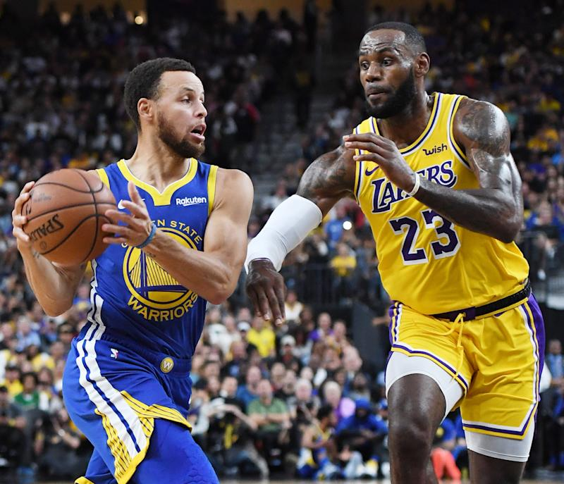 LAS VEGAS, NEVADA - OCTOBER 10: Stephen Curry #30 of the Golden State Warriors drives against LeBron James #23 of the Los Angeles Lakers during their preseason game at T-Mobile Arena on October 10, 2018 in Las Vegas, Nevada. The Lakers defeated the Warriors 123-113. NOTE TO USER: User expressly acknowledges and agrees that, by downloading and or using this photograph, User is consenting to the terms and conditions of the Getty Images License Agreement. (Photo by Ethan Miller/Getty Images)