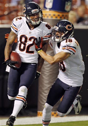 Chicago Bears' Brittan Golden (82) celebrates with teammate Dane Sanzenbacher (18) after Golden returned a blocked punt for a touchdown against the Cleveland Browns in the third quarter of a preseason NFL football game, Thursday, Aug. 30, 2012, in Cleveland. The Bears won 28-20. (AP Photo/Ron Schwane)